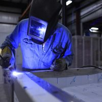 Welder working in a factory