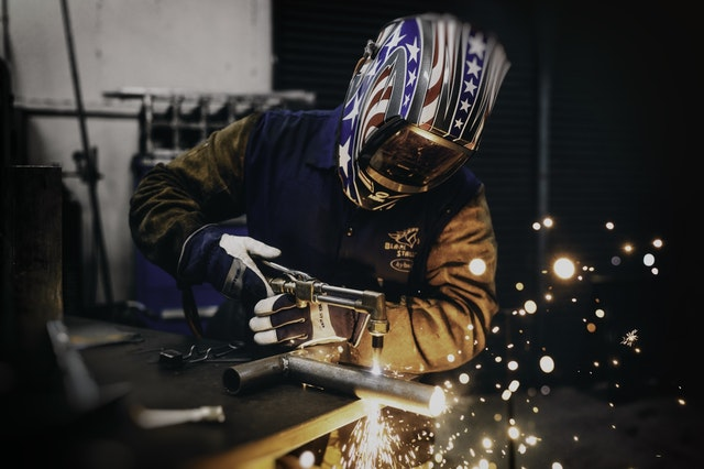 Illinois construction worker welding metal