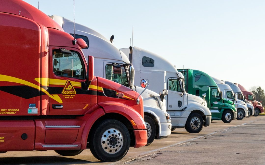 How does workers' compensation work in the trucking industry?